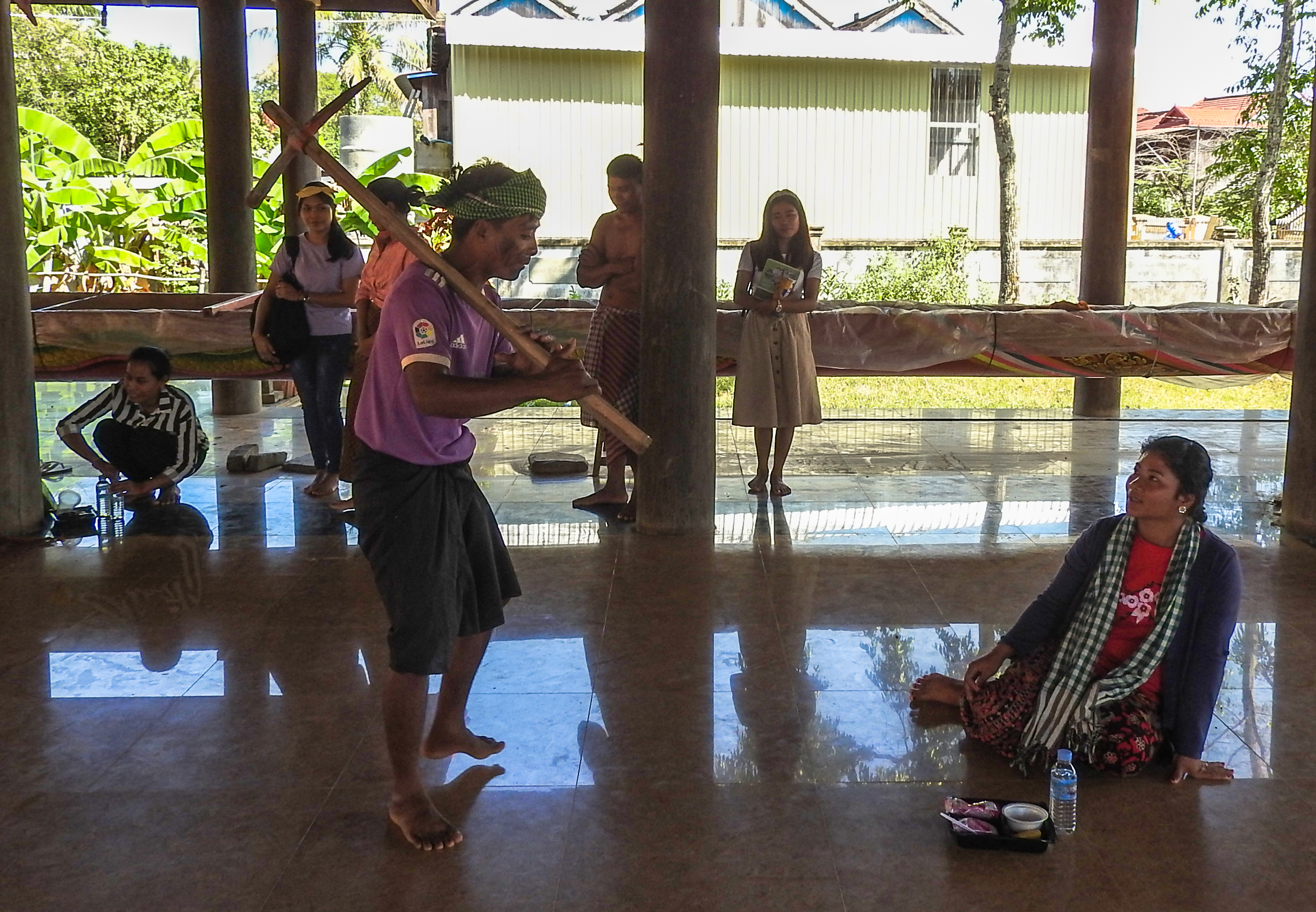 Jokers and youth from Sambo district perform a story of illegal fishing that very often happens in the Mekong River.