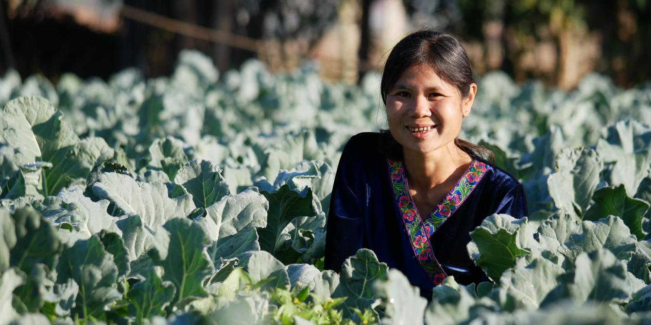 Daw Aye Kyi shows her thriving vegetable garden along Loikaw stream, which connects her village to the Salween River.