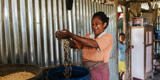 Oecusse, Timor-Leste: Sabina Foni showsher corn harvest that was recently picked from her permanent garden supported by Oxfam'sStrengthening Community Livelihoods (Haforsa) Program.