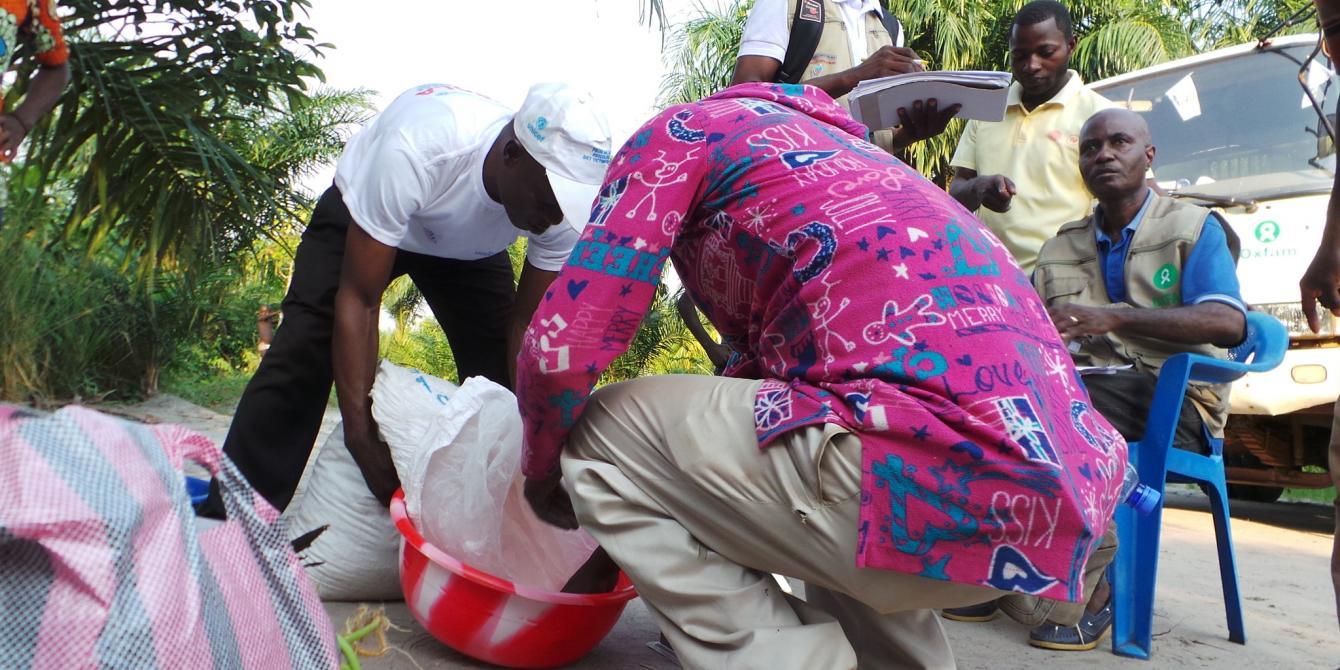 Oxfam distributing rice, beans and flour to about 4,525 people during the Ebola outbreak in Equateur province.