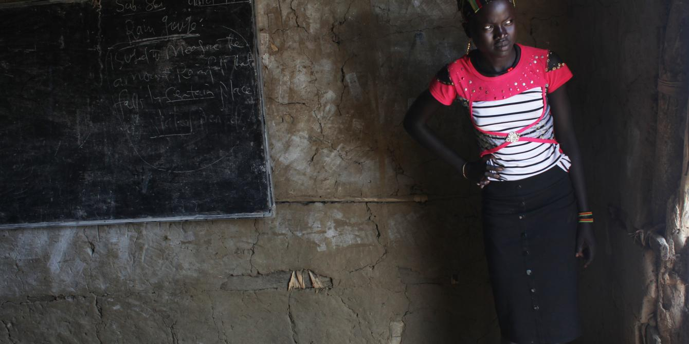 A girl looks out of her classroom in Nyal. Andreea Campeanu/Oxfam