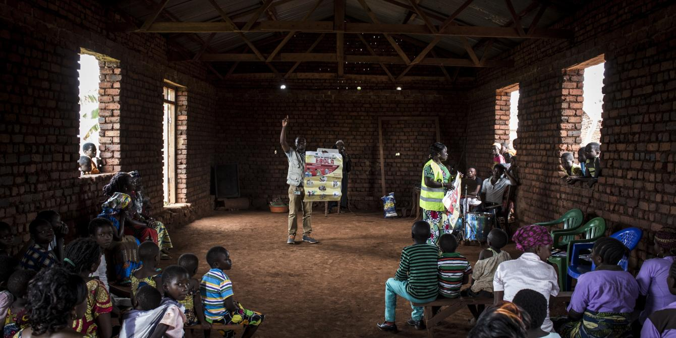 Espoir Mahamba, a public health promoter for Oxfam, teaches a church congregation in Mangina about Ebola. John Wessels/Oxfam