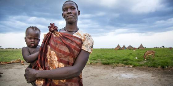 Tahrir, 25, a mother of 4 children, holds her baby in Padding, in Jonglei, South Sudan. Albert González Farran/Oxfam