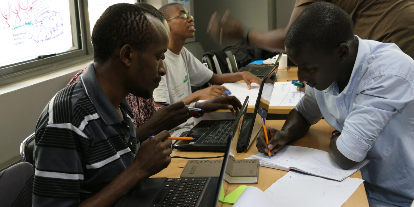 Hackers and CSO members discussing a budget monitoring system during a hackathon. Photo Credit: Joyce Kabue