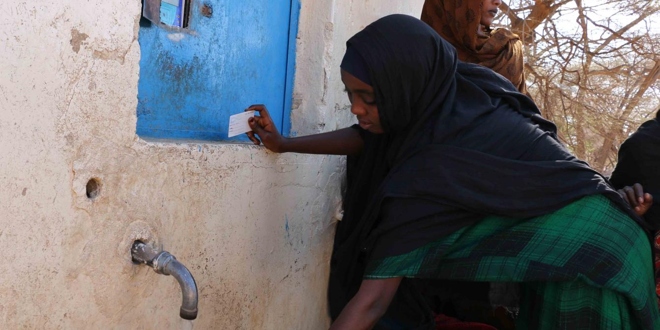Women using the water ATM to fetch water in Wajir County. Photo Credit/Kevin Wabung'o/Oxfam