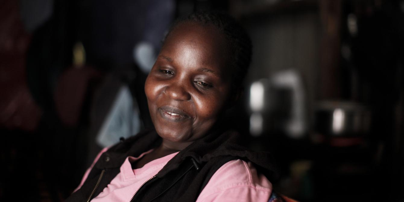 Grace Ondieke, a mother of 3, sits in her house in Mukuru informal settlement, in Nairobi, Kenya. Photo Credit: Sam Tarling