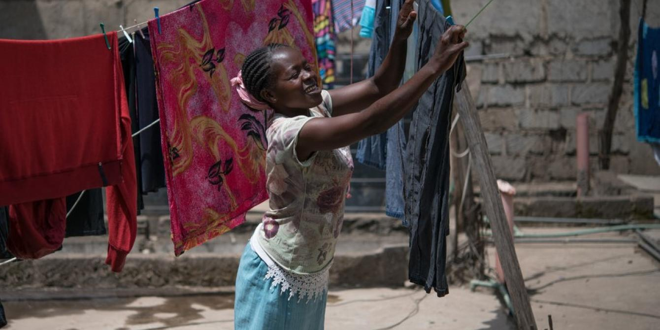 Tabitha Mwikali, 36, a domestic worker hanging clothes for her employer in Eastleigh, Nairobi, Kenya. 2016