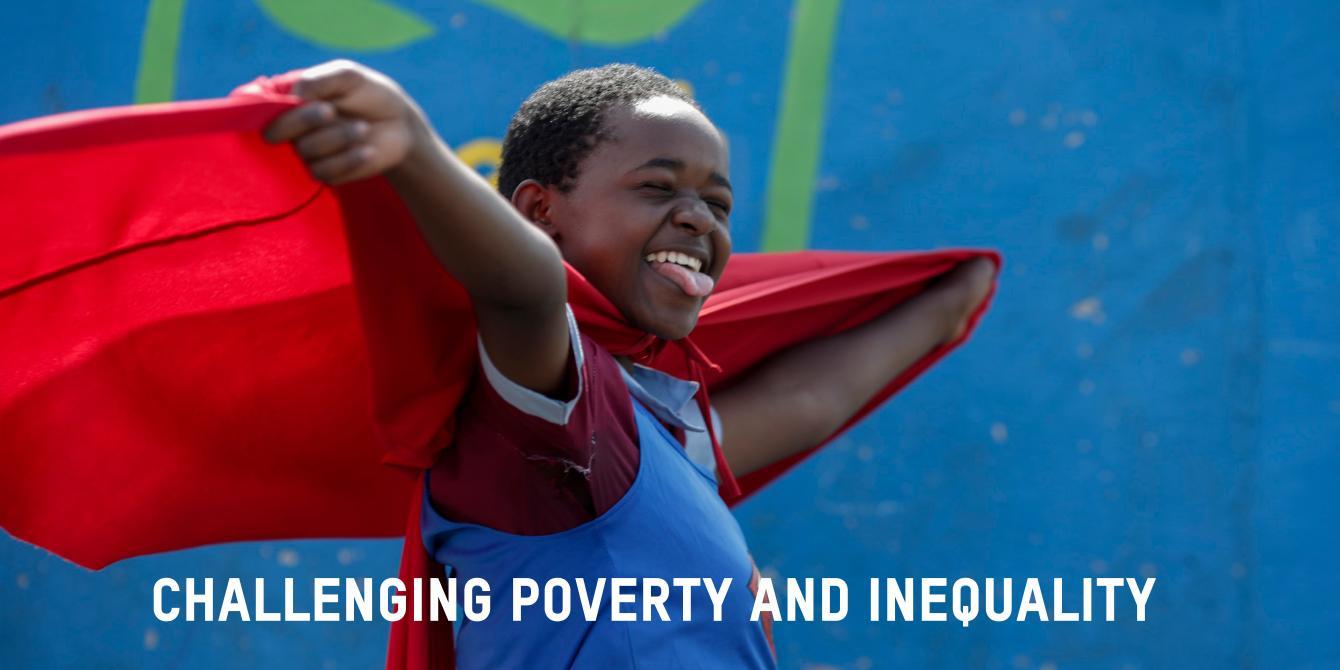 Pauline Mokaya, 13, dressed as Super Woman, takes part in an Oxfam campaign to promote Sanergy Fresh Life toilets at the Reuben Baptist School, in the Mukuru informal settlement, in Nairobi, Kenya. Photo Credit Sam Tarling/Oxfam