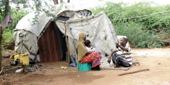 Fatuma Juma, her husband and last born daughter outside their makeshift house. Photo credit/Jeremy Mutiso