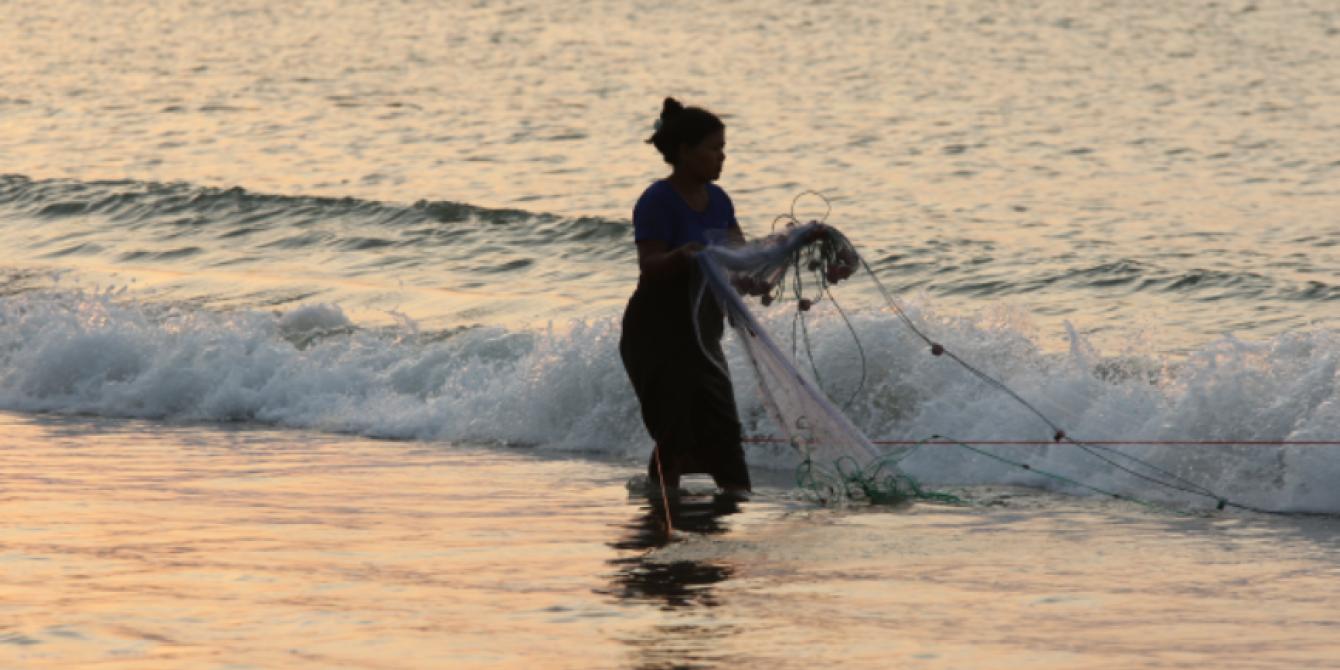 Local Women carrying a fishing net in Kyauk Phyu, Rakhine state