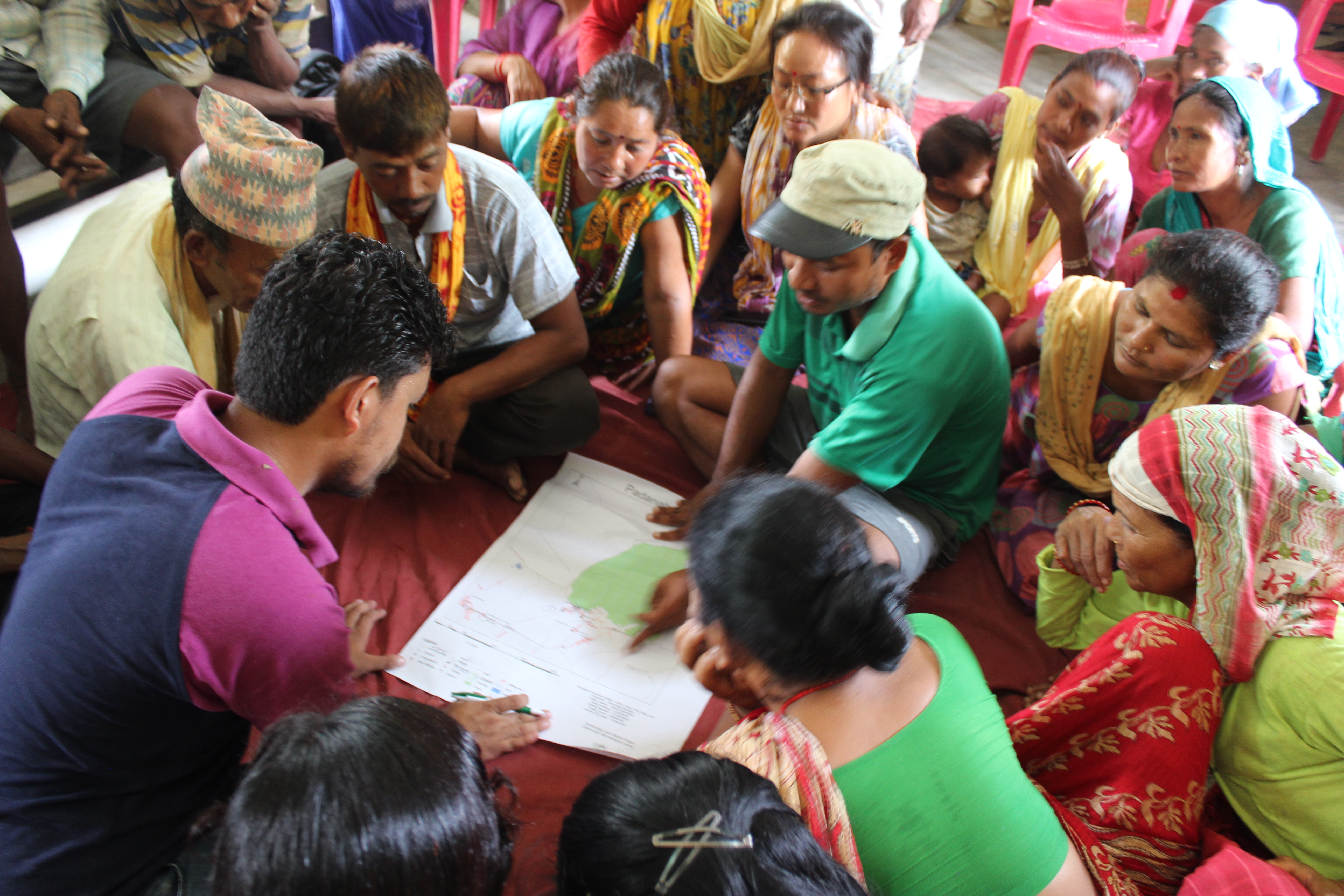 Preparing a village map as part of making by-laws - Credit: Rasna Dhakal/Oxfam