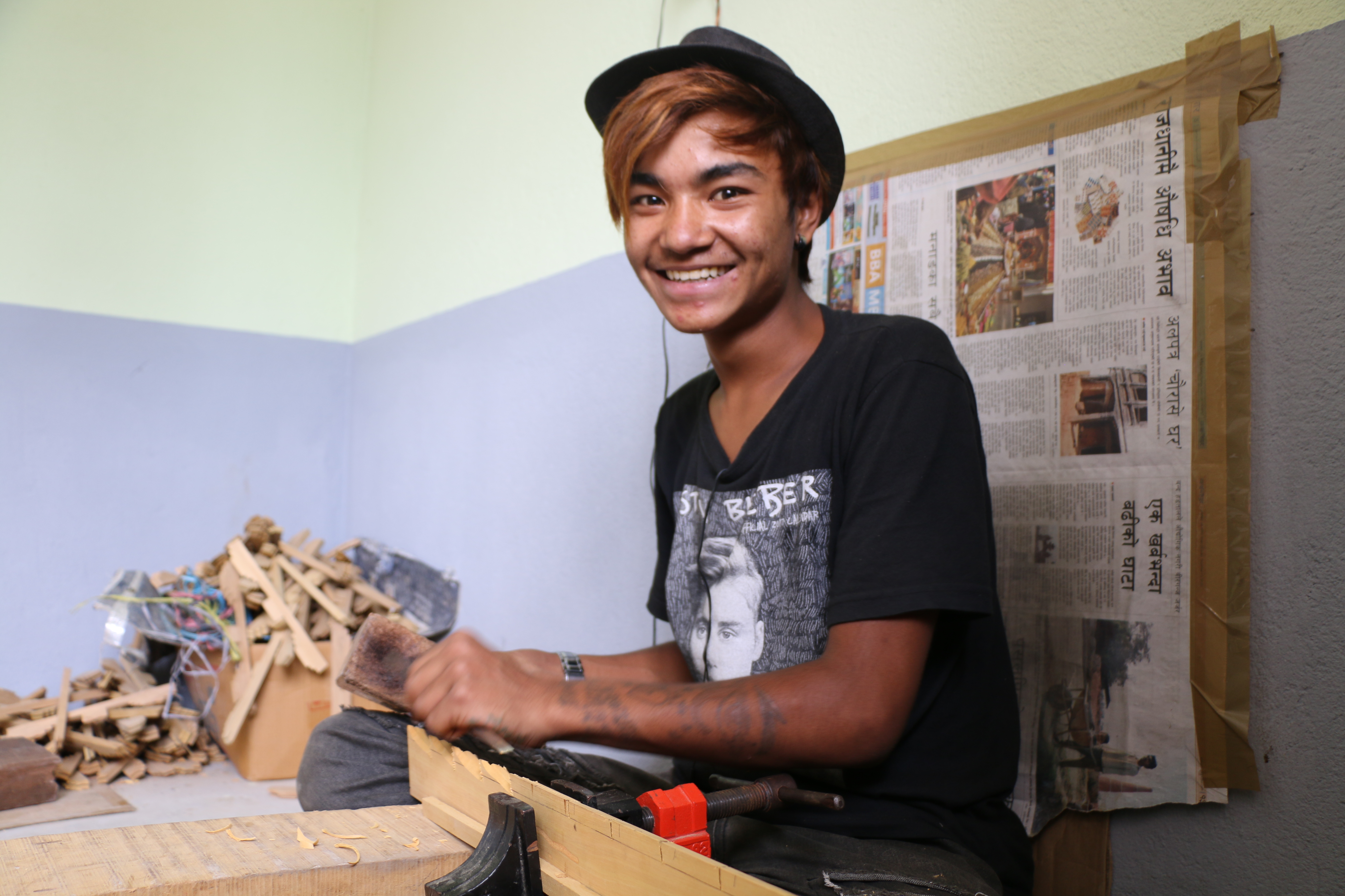 Roshan Thapa carving a window frame