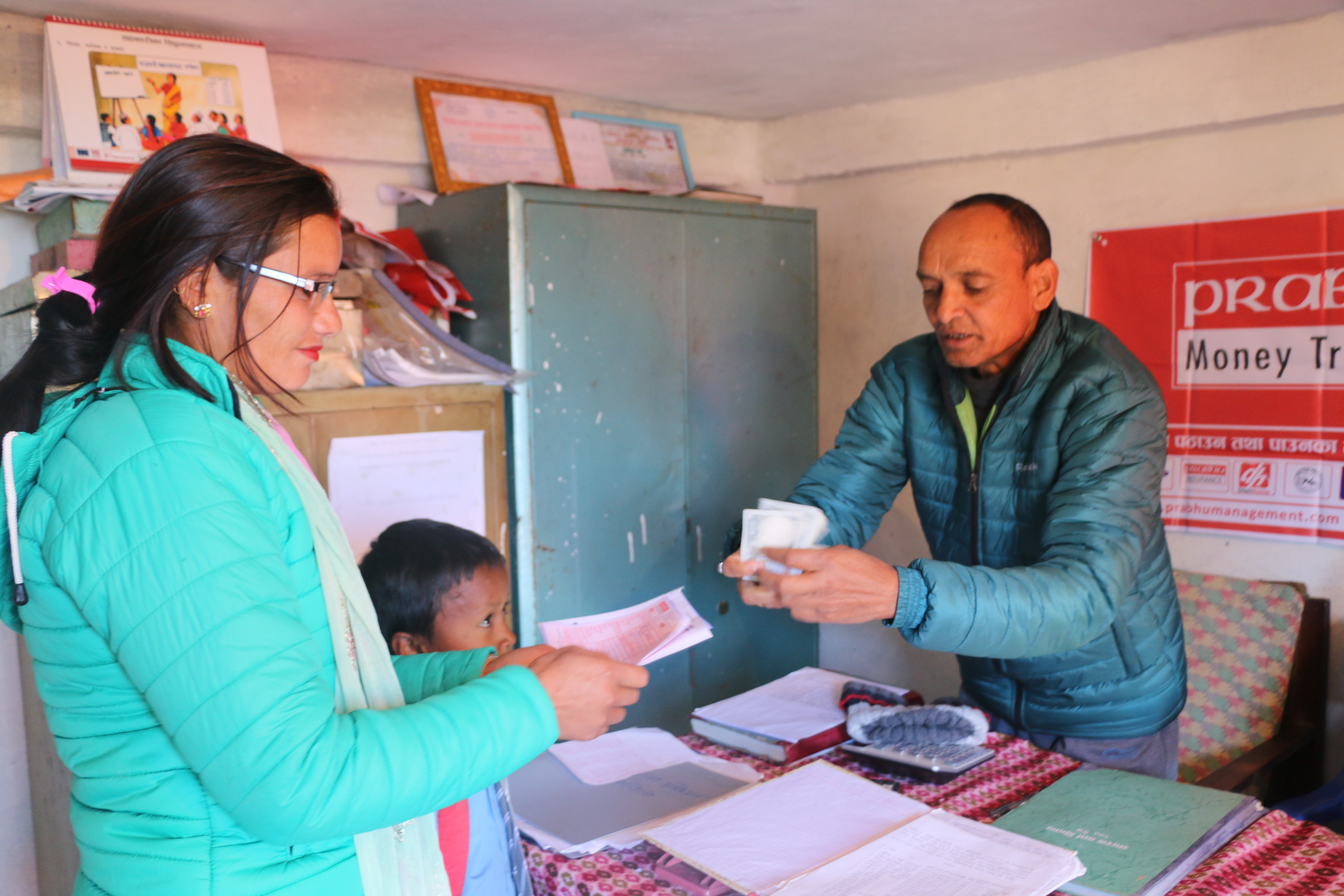 Bhagirathi Bhandari, receiving money sent by husband from Rukum