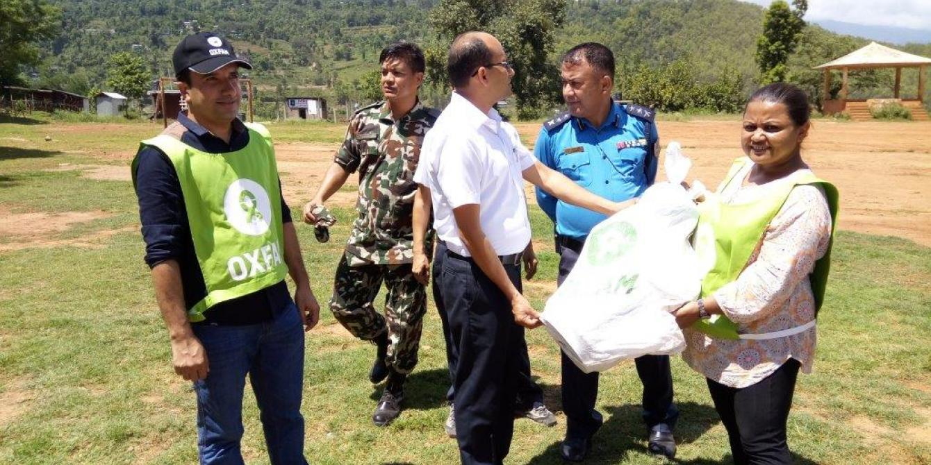 Oxfam handing relief items to the CDO