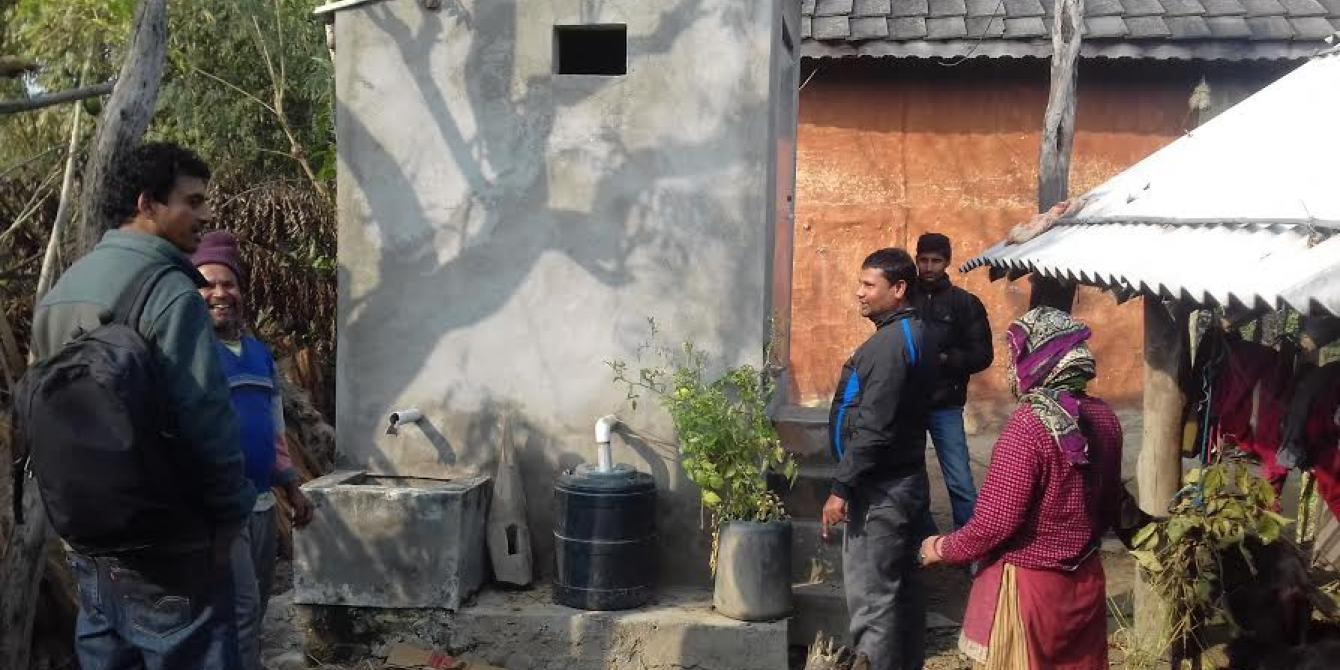 Santa Bahadur Ghimire (second from left), the proud pioneer of eco-san toilets - Credit: Sumeru Tripathee/Oxfam