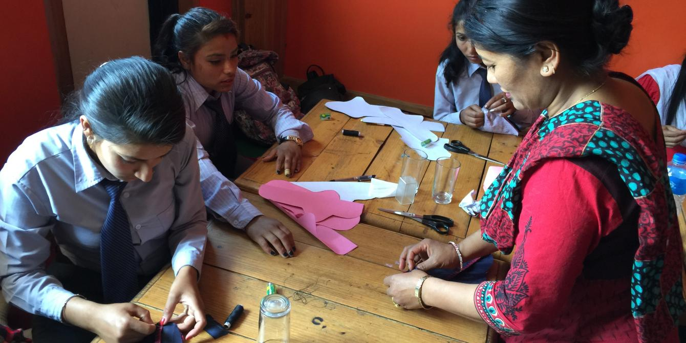 College students learning new skills to make sanitary napkins