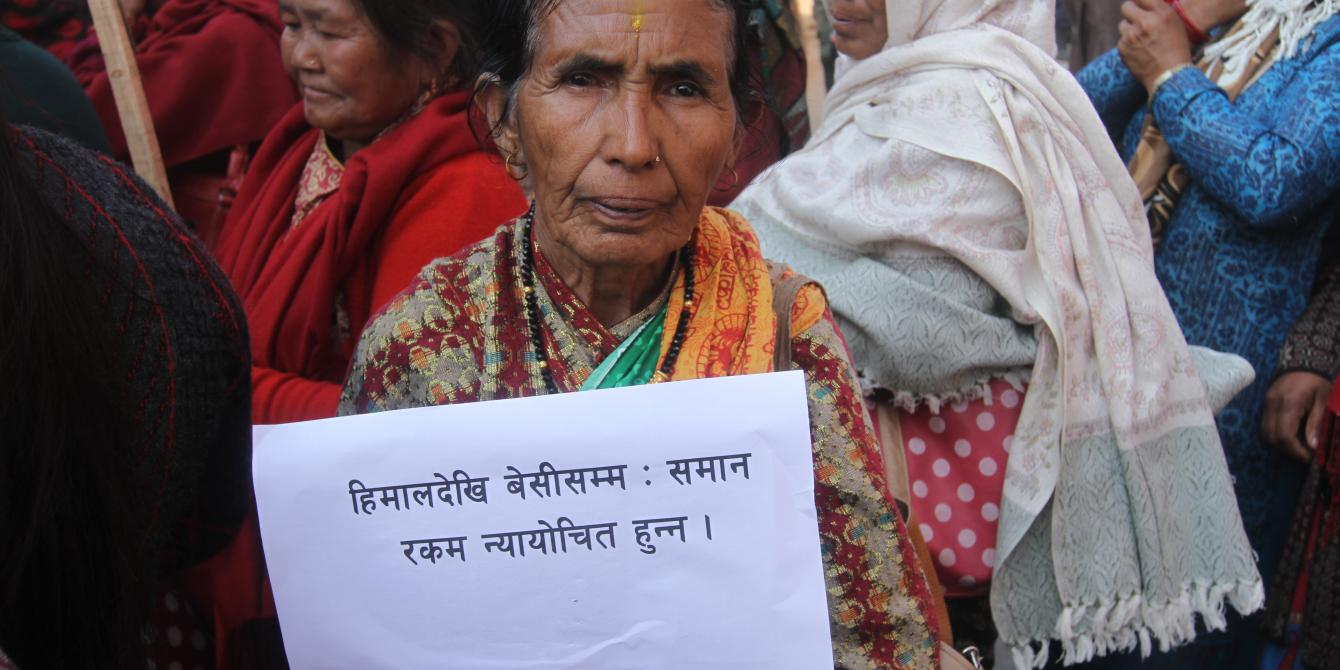 A woman demanding fair reconstruction grant in Gorkha.