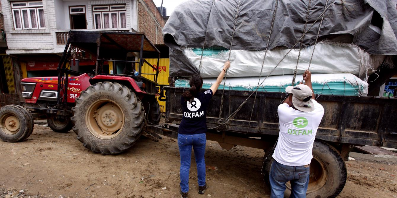 Oxfam staff loading supplies for earthquake-affected families in Nepal