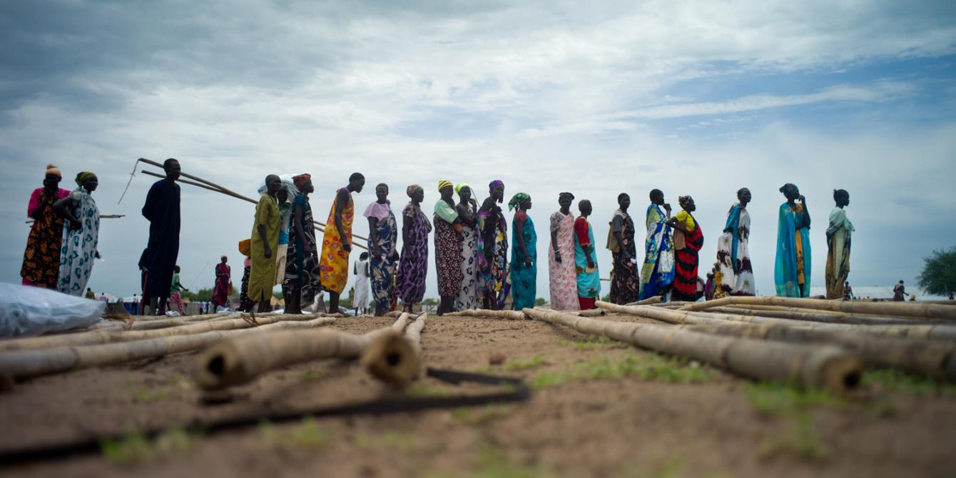 Internally displaced persons receiving humanitarian supplies in a camp in Juba, South Sudan