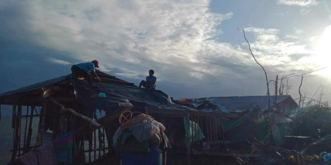 Fisherfolk from Palanas village in Salcedo, Eastern Samar, attempt to repair their damaged homes with tarpaulins a day after Christmas. Typhon Ursula first made landfall in Salcedo on December 24.Photo credit:Charita Llanera/PDRRN