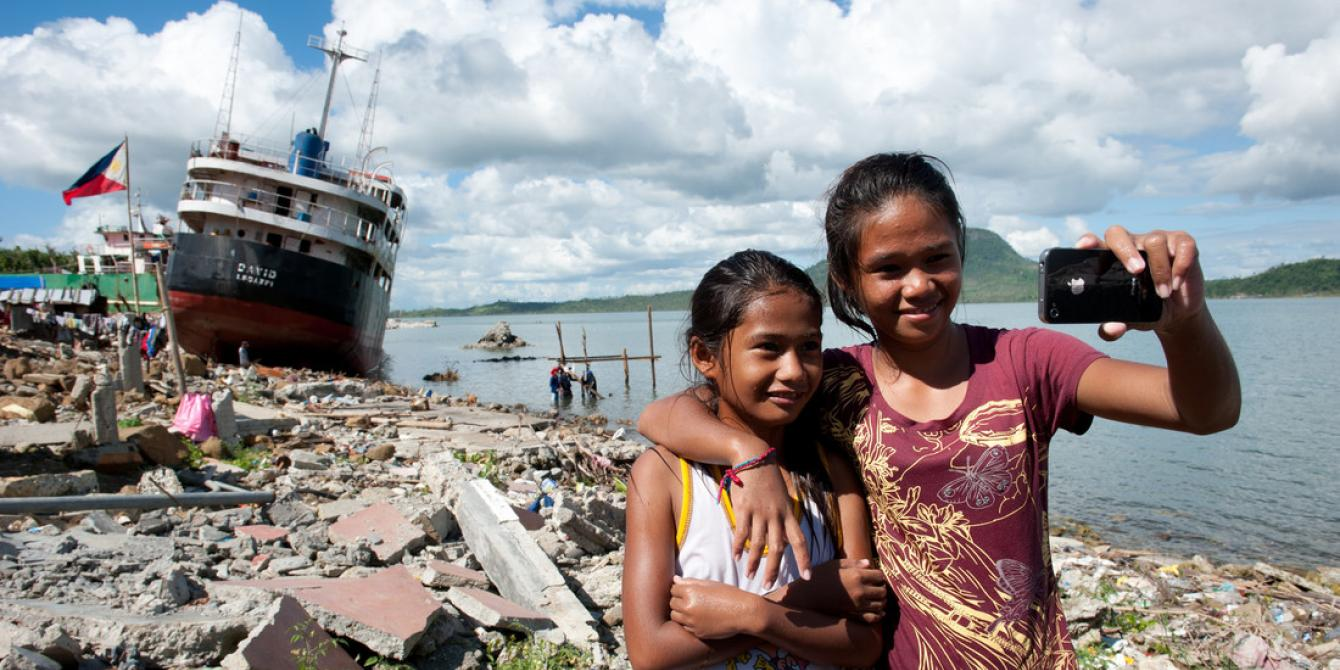 Mary Ann (10) and Mary Grace (14) stand in front of Anibong Bay in Tacloban. Both girls are recipients of Oxfam Hygiene Kit in January 2014. (Photo: Eleanor Farmer/Oxfam)
