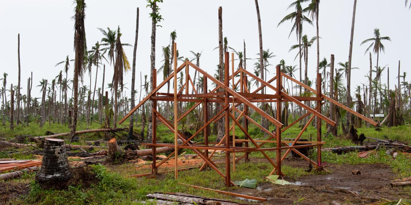 The frame of a house made from coconut lumber in Tolosahay, Julita.  (Photo: Eleanor Farmer/Oxfam)
