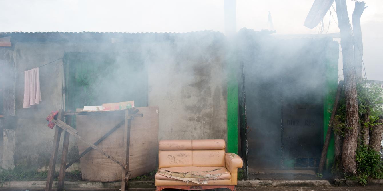 Rey Ann Corbin's house in Barangay 83-B, Tacloban is 'fogged' to eliminate mosquitoes. (Photo: Eleanor Farmer/Oxfam)