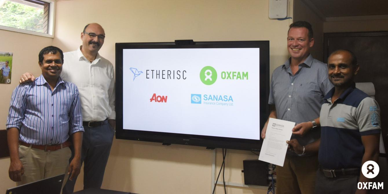 Oxfam and partners at the launch of the blockchain system