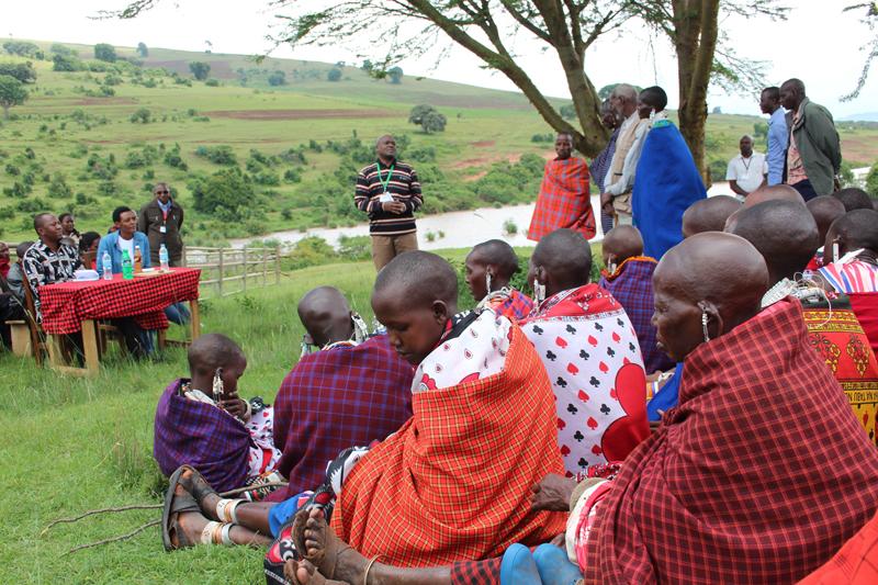 Laurent Wambura, a Pastoralist program manager with Oxfam speaking during the heifers' handover ceremony. Photo: Bill Marwa / Oxfam