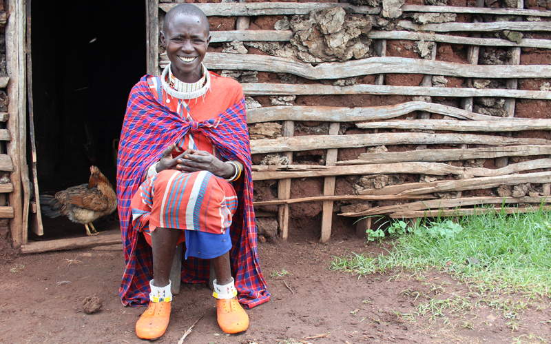 Nosiruayi is all smiles at her house in Enguserosambu village. Photo: Bill Marwa / Oxfam