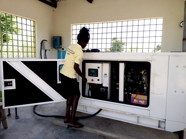 Jane checks for information from the pump. Photo:Oxfam