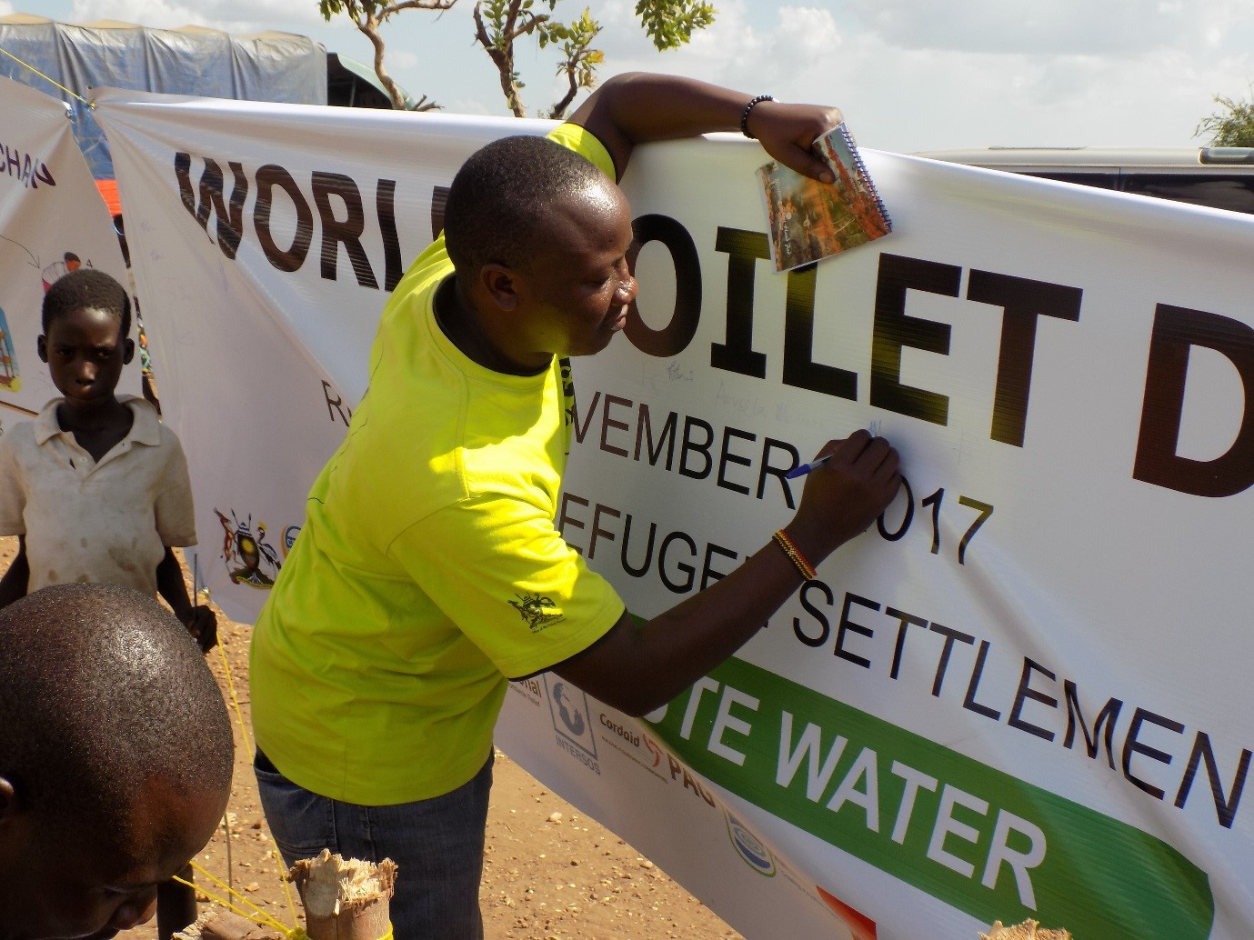 Public Health Promotion Team Leader Rashid Mawejje in Ofua 3 during World Toilet Day commemoration. photo credit:Oxfam