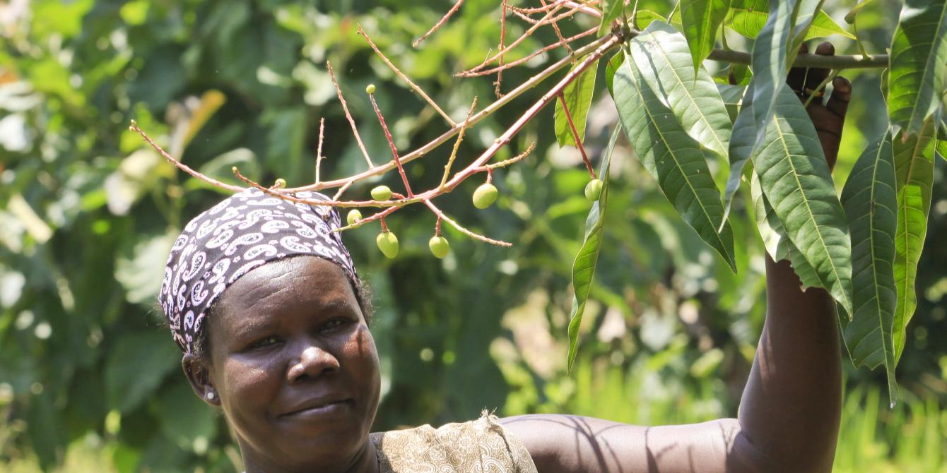 """Vita from Arua by her mango tree. She says """"I  believe in taking care of the environment because we  live off it and if it's destroyed, we will not survive. """""""