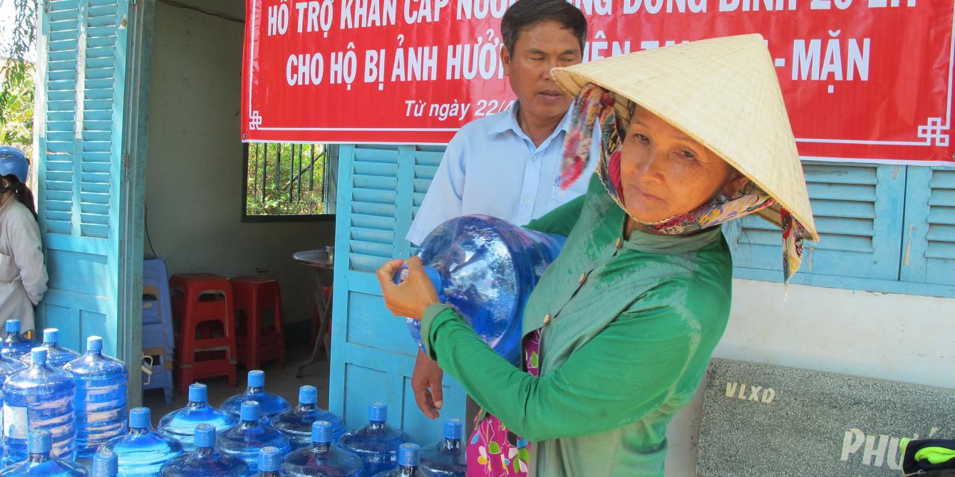 Rural women carries water in Ben Tre province. Credit: Oxfam Vietnam